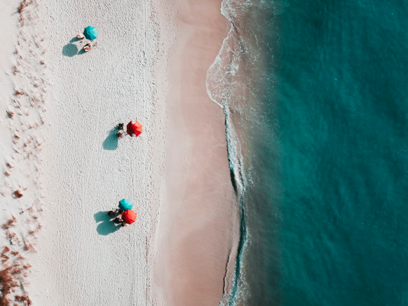 beach umbrellas white sand beach ocean